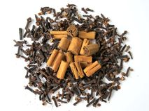 Cinnamon and cloves. On white background Stock Image