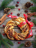 Cinnamon cocoa brown sugar wreath buns. Sweet Homemade christmas baking. Roll bread, spices, decoration on wooden background. New Stock Photo