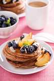 Cinnamon coconut flour pancakes with fresh fruits Royalty Free Stock Photos