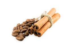 Cinnamon and coffee. Cinnamon sticks to the right on coffee beans Royalty Free Stock Images