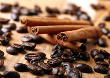 Cinnamon with coffee beans Stock Images