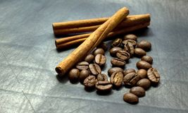 Cinnamon and coffee beans on a black background Royalty Free Stock Photos