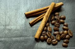 Cinnamon and coffee beans on a black background Royalty Free Stock Image
