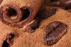Cinnamon and coffee beans and ground closeup. macro. Stock Photo