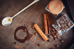 Cinnamon with coffee beans and hot chocolate blot Royalty Free Stock Photo