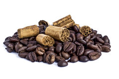 Cinnamon and coffee beans. Cinnamon sticks and coffee beans on white background Royalty Free Stock Photos