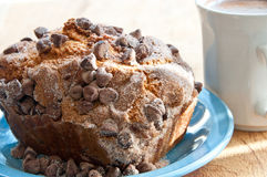 Cinnamon coffee cake with chocolate chips on a plate Stock Photos
