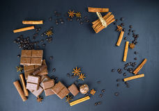 Cinnamon, coffee, chocolate. Background for the sweet tooth. Sweet Dreams. Chocolate,coffee grain, cinnamon, star anise, candy on a dark background. Top view Stock Image