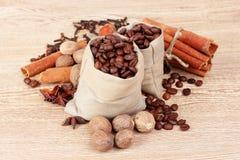 Cinnamon, coffee, nutmeg and hazelnut on wooden Stock Image