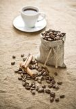 Cinnamon and coffee on sacking Stock Photos