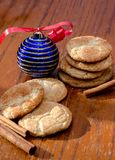 Cinnamon cookies for Christmas. Home made Cinnamon cookies, called snickerdoodles,  are a gift for for Christmas with cinnamon sticks and a festive blue ornament Stock Photo