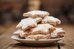 Cinnamon cookies and christmas lights Royalty Free Stock Photography