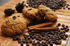 Cinnamon, cookies and coffee beans Stock Photos
