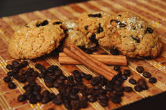 Cinnamon, cookies and coffee beans Royalty Free Stock Photos