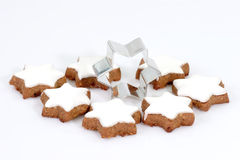 Cinnamon Cookies With Cutter. Cinnamon cookies with cookie cutter on bright background Stock Images