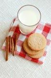 Cinnamon cookies with milk. Cinnamon cookies with glass of milk Stock Photo