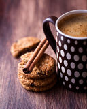 Cinnamon cookies with nuts and mug of delicious co Royalty Free Stock Image