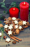 Cinnamon cookies, nuts and spices with christmas decoration Stock Images