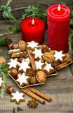 Cinnamon cookies, nuts and spieces with christmas decoration Stock Image