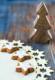 Cinnamon cookies and wooden Christmas tree. On a wooden background Stock Photo