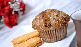 Cinnamon crumble muffin and tea. Cinnamon crumble muffin, cookies and tea with table set rose Stock Photography