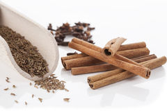 Cinnamon, cumin and cloves, isolated Royalty Free Stock Photo