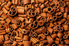 Cinnamon curls background Royalty Free Stock Photo