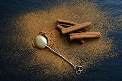 Cinnamon on a dark backround. Cinnamon on a dark, stone backround Stock Images
