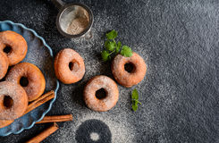 Cinnamon doughnuts. Traditional American doughnuts with cinnamon and sugar icing Stock Photo