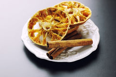 Cinnamon and dried orange slices Royalty Free Stock Photography