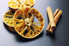 Cinnamon and dried orange slices Royalty Free Stock Photo