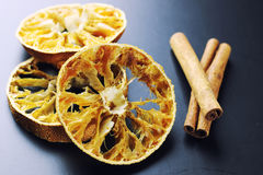 Cinnamon and dried orange slices Stock Photography