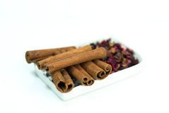 Cinnamon and dried rosehips Stock Photo