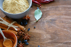 Cinnamon, ginger, star anise on wooden background Stock Photo