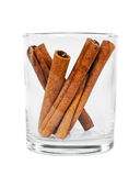 Cinnamon in a glass. Some sticks of cinnamon in a glass are isolated on the white Royalty Free Stock Photo