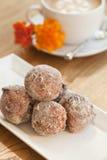 Cinnamon and golden raisin beignets Royalty Free Stock Photography