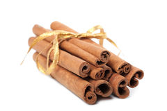 Cinnamon with golden ribbon isolated Stock Photo