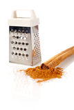 Cinnamon and grater Stock Images