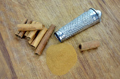 Cinnamon and grater Royalty Free Stock Image