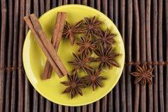 Cinnamon on Green Plate Stock Photo