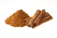 Cinnamon. In Ground and Stick on White Stock Photos