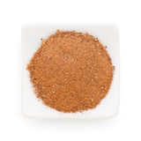 Cinnamon ground in a white bowl stock photography