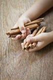 Cinnamon in hand Stock Photo