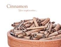 Cinnamon heap at white Royalty Free Stock Photo