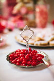Cinnamon Hearts Candy Display. Cinnamon Hearts Candy on a vintage silver tray at a candy buffet dessert table at a love themed wedding reception Royalty Free Stock Images