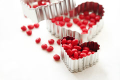 Cinnamon hearts and cookie cutters Royalty Free Stock Images