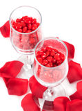 Cinnamon Hearts in Two Champagne Glasses. A top angled closeup view of two champagne glasses with sharp focus on the cinnamon heart candies in the glasses and Stock Photography
