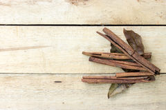 Cinnamon and herb sticks on  wooden Stock Photos