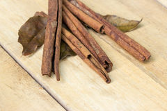 Cinnamon and herb sticks on  wooden Stock Photo