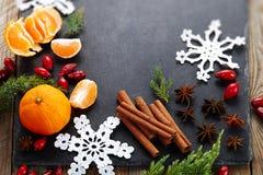 Cinnamon,hips, crochet snowflake,fir  on dark vintage background.Christmas holiday. Stock Photography